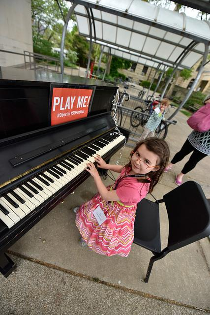 Photograph of a child playing the piano.