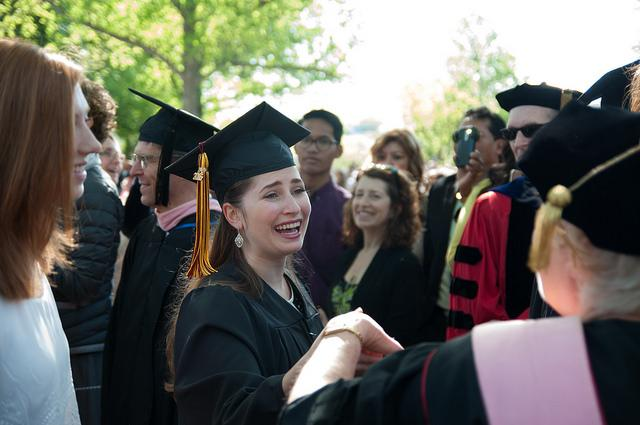 Photo of a crowd of people dressed in commencement regalia