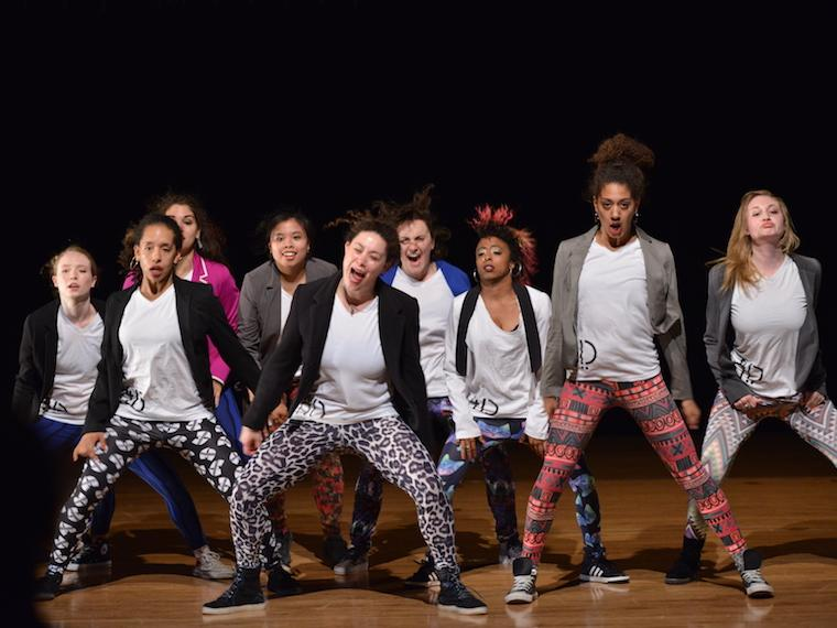 group of hip-hop dancers on stage