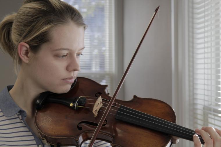 A woman plays violin