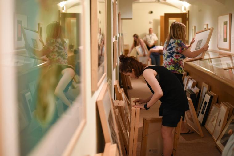 Students browsing the art rental collection.