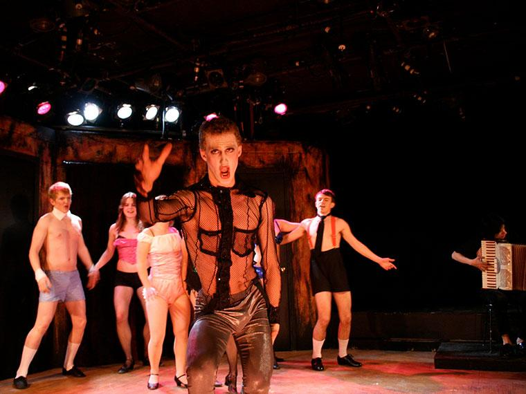 Foreground: Raphael Sacks as Master of Ceremonies. Background: Sean Lucius as Bobby, Holly Heidt as Rosie, Aaron Kokotek as Victor/Sailor in Cabaret, by John Kander and Freb Ebb, Directed by Joshua Sobel, Feb 14-17, 2008