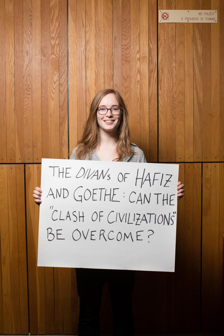 Photograph of woman holding a poster board.