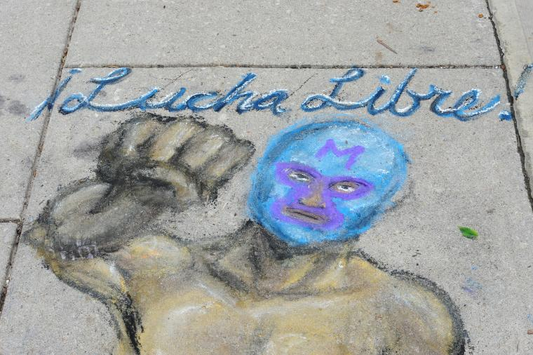 "Chalk drawing of a masked man with the words ""Lucha Libre"""