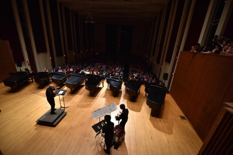 Eight pianists perform simultaneously on stage