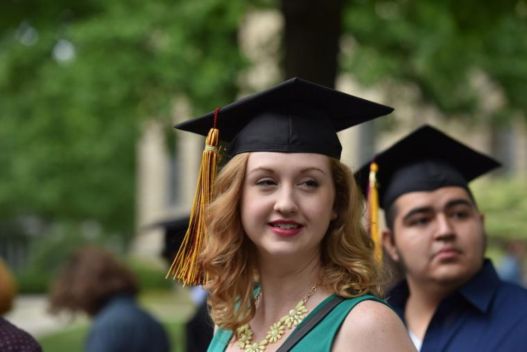A woman in commencement regalia