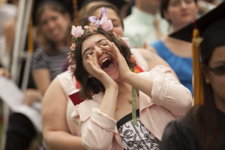 A person with a floral headdress shouts