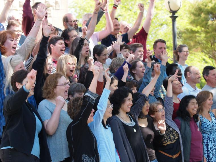 A group of people raising their hands