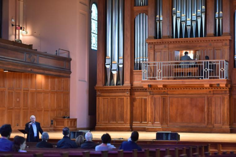 People attend an organ performance