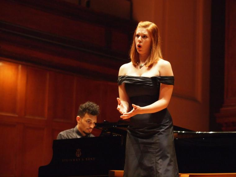 A vocalist performs while a pianist accompanies