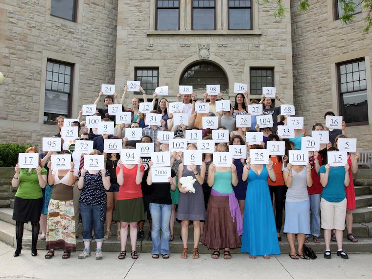 Photo of Class of 2006 with cards at CRW 2011