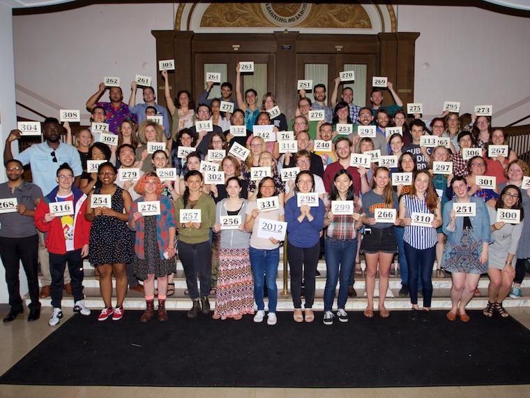 Photo of Class of 2012 with cards at CRW 2017