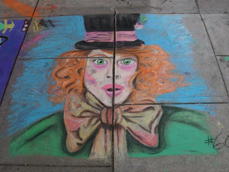 A chalk drawing of a cartoonish person