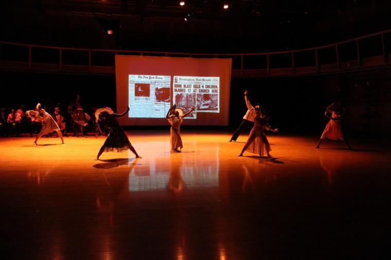 Photograph of six dancers performing.