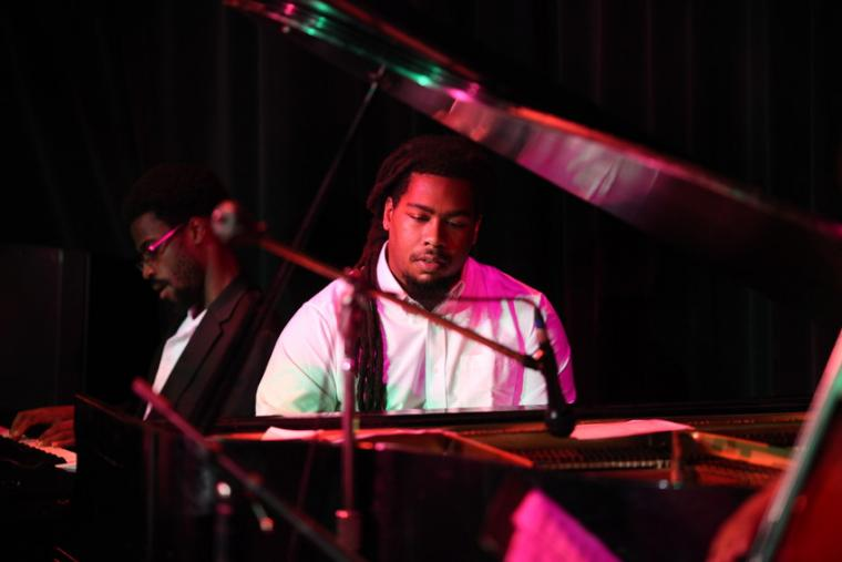 Photograph of a man playing a piano