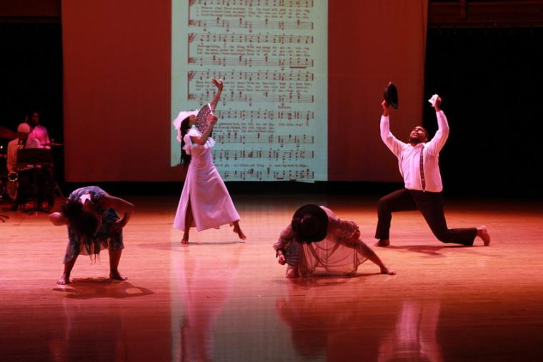 Photograph of four dancers performing.