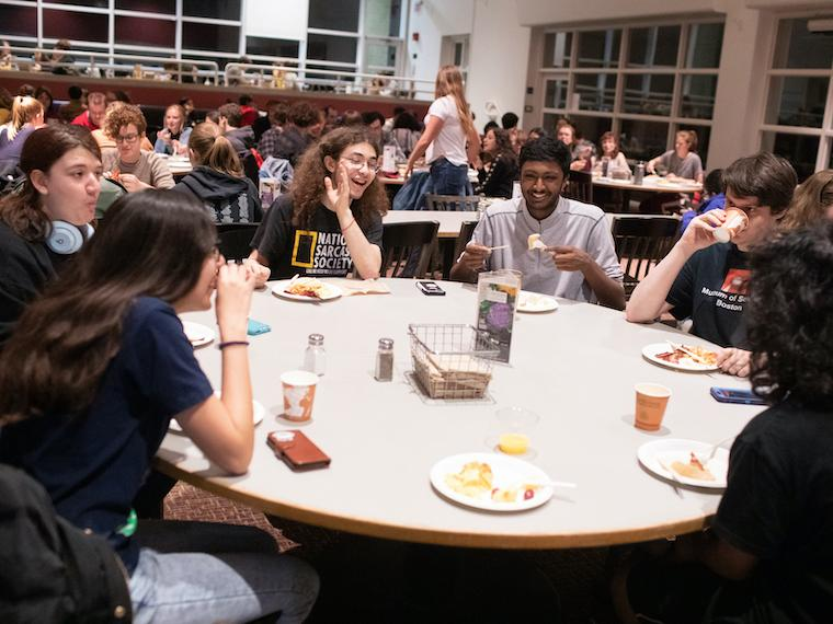Students sitting at a table in Stevenson Dining Hall.