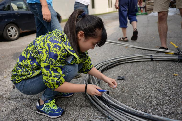Photograph of woman working with wires.