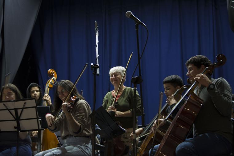PACE professor Louise Zeitlin looks out over the orchestra