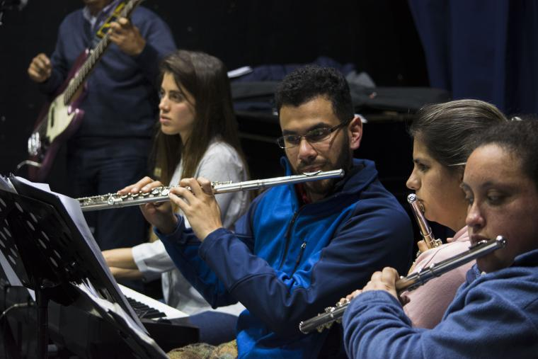 Gabriel Cruz-Ruiz (center) performs with fellow flutists