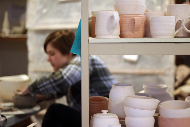 Pottery stacked on shelves