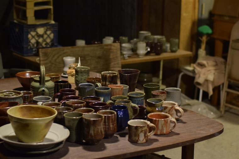 Pottery pieces fill a table