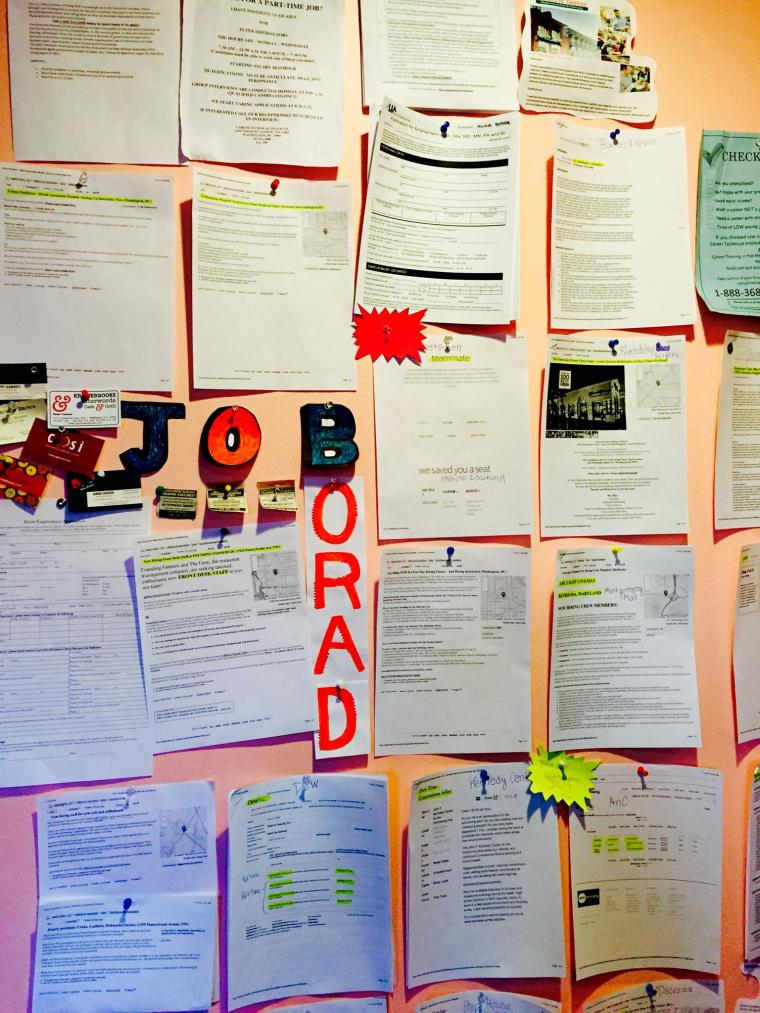 "An array of papers pinned to a wall titled ""Job Board"""