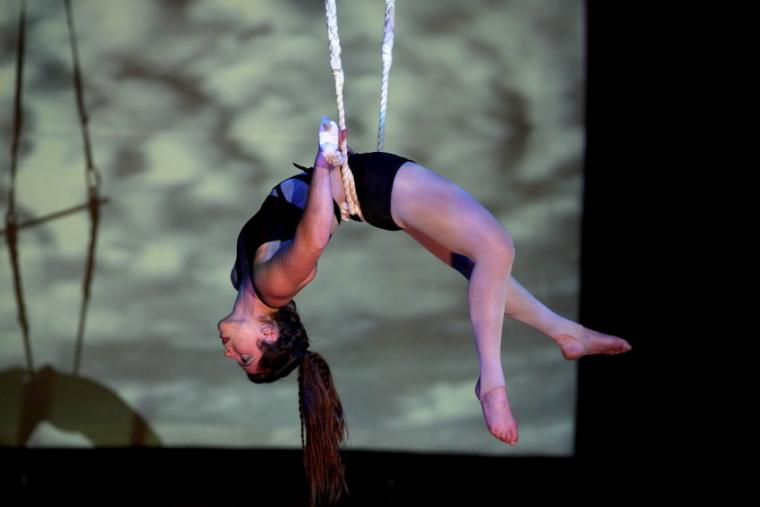 A woman performs a trapeze routine