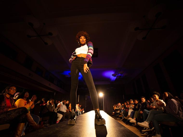 person modeling during fashion show during Black History Month 2019.