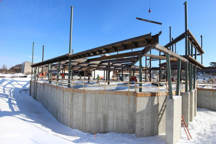Photograph of a building construction in the winter.