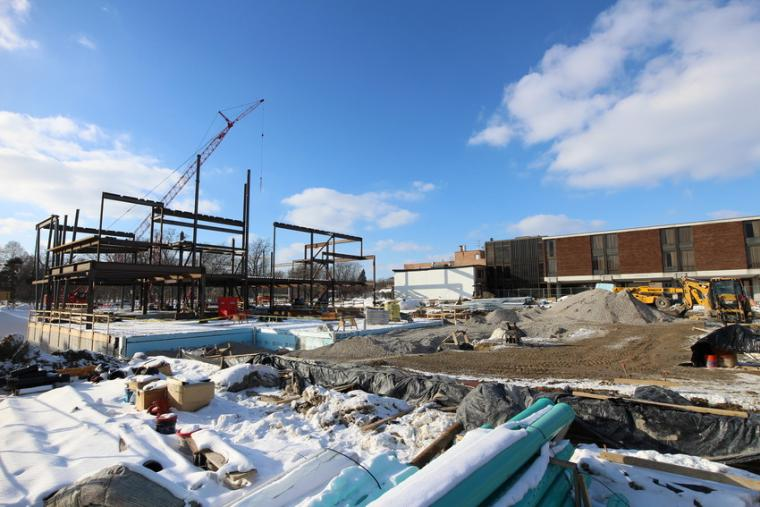 Photograph of a construction site in the winter.