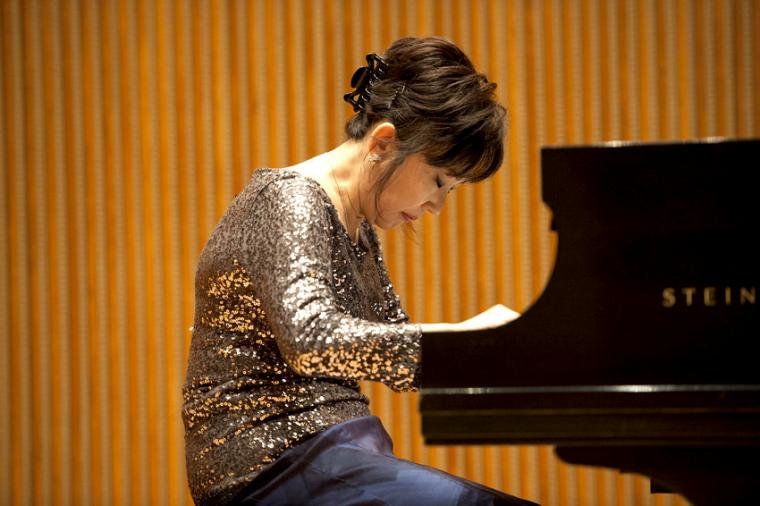 A woman plays the piano