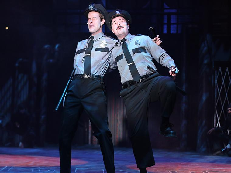 Julian Guerrieri as Officer Lockstock, Connor O'Loughlin as Officer Barrel in Urinetown: The Musical, by Greg Kotis, Music by Mark Hollmann, Lyrics by Mark Hollmann and Greg Kotis, Directed by Matt Wright, Dec 5-8, 2019