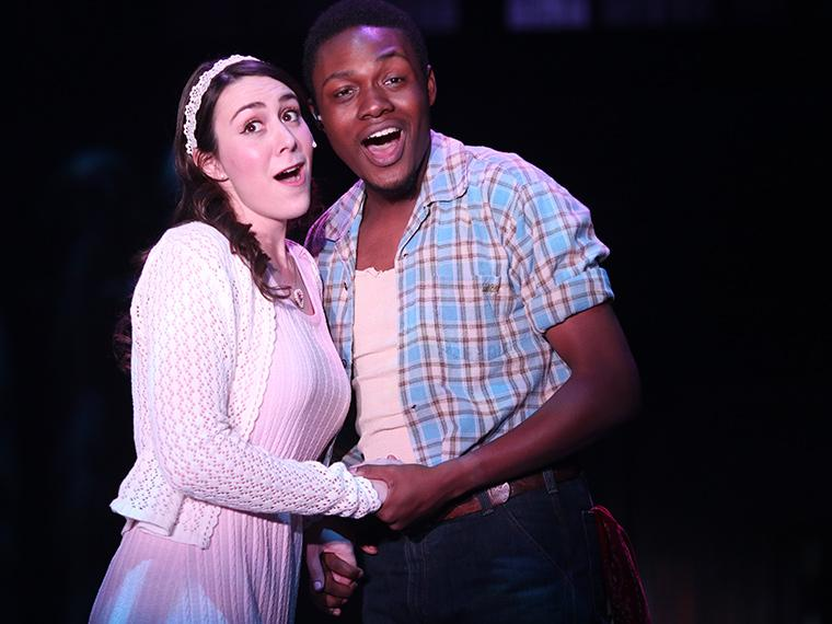 Marina Wright as Hope Cladwell, Nasir Butler as Bobby Strong in Urinetown: The Musical, by Greg Kotis, Music by Mark Hollmann, Lyrics by Mark Hollmann and Greg Kotis, Directed by Matt Wright, Dec 5-8, 2019