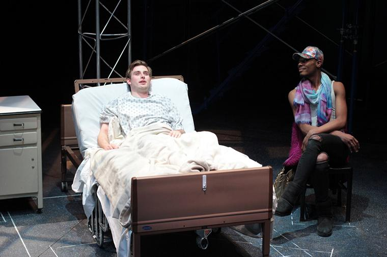 Evan Board as Prior Walter, Seyquan Mack as Belize in Angels in America Part One: Millennium Approaches, by Tony Kushner, Directed by Matthew Wright, Hall Auditorium, Apr 12-21, 2018