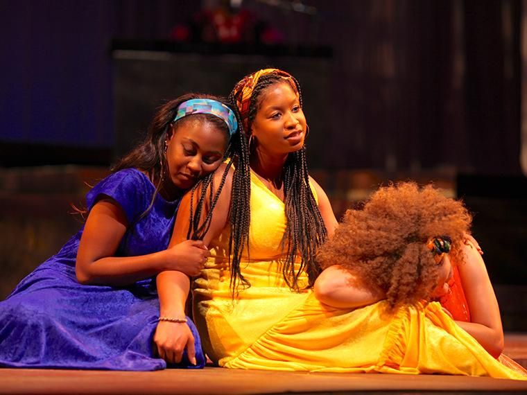 Victoria Ellington as Lady in Blue, Deja Alexander as Lady in Yellow, Kiela Nelson as Lady in Orange in for colored girls who have considered suicide / when the rainbow is enuf, written by Ntozake Shange, Directed by Caroline Jackson Smith, Hall Auditorium, Apr 13-16, 2017