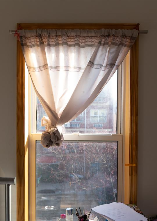 A curtain in a lit room.