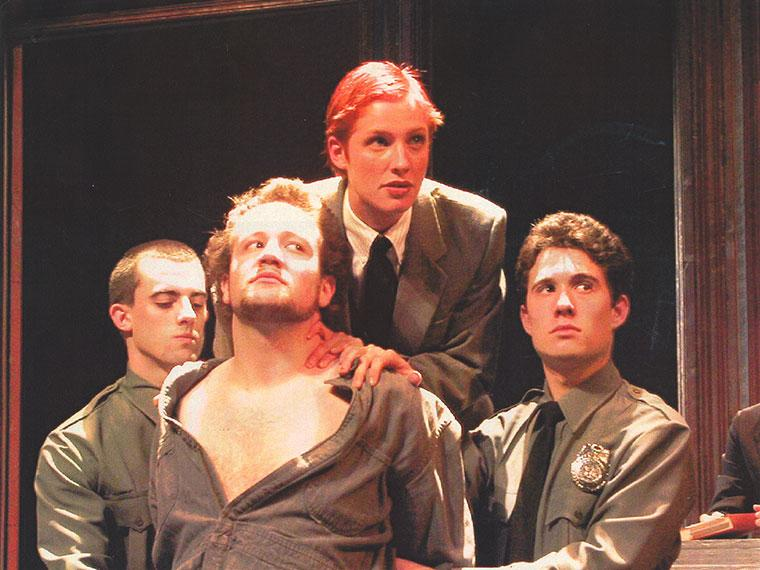 Garrett Monaghan as Ensemble, John Zajac as Antonio, Mary Ross as Portia, Avery Monsen as Ensemble in The Merchant of Venice, May 2-4, 2003