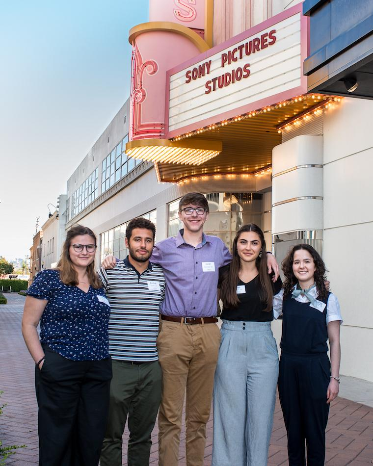 Five interns pose under the Sony Pictures Studios marquee