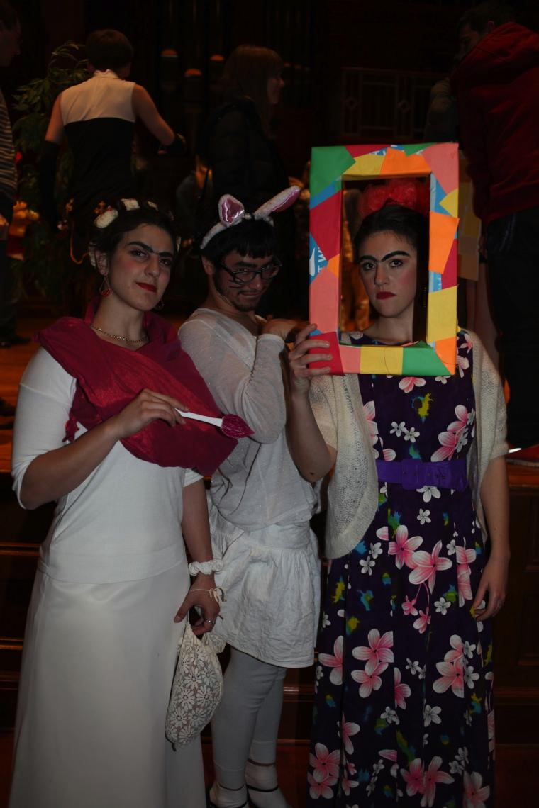 Three costumed people pose for a photo