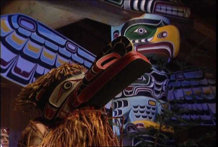 Photograph of colorful totem poles.