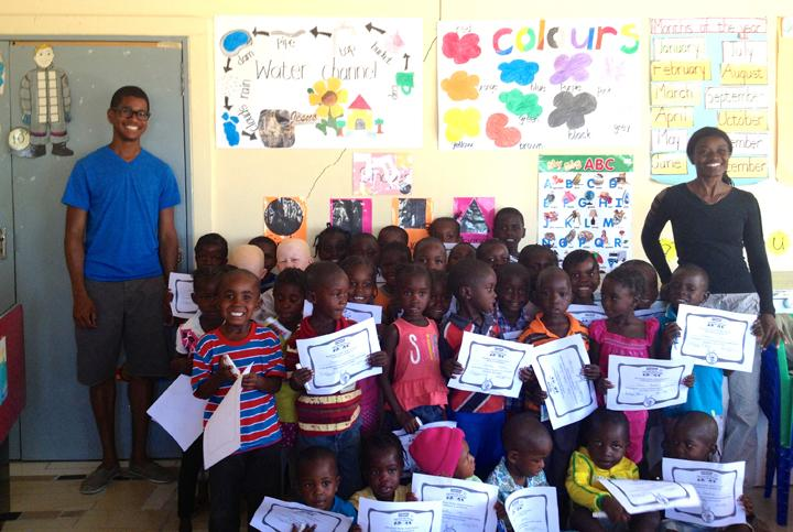 Photograph of Richard McGuire '14 with a group of children in Nambia, Africa.