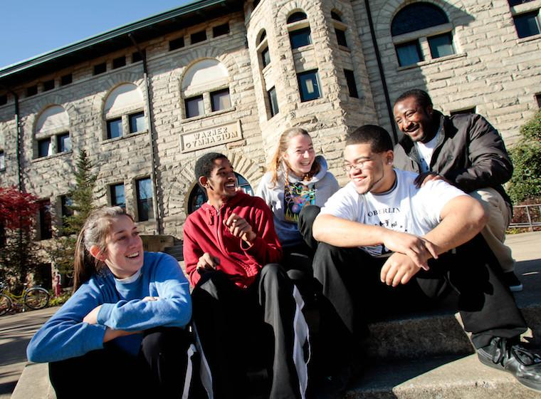 Students sitting together in front of Warner Center.