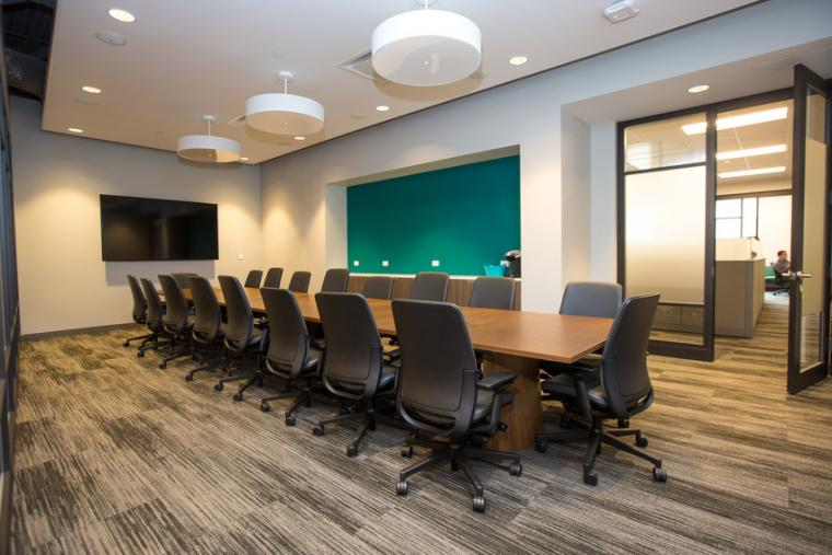 Photo of a conference room with a long table and chairs