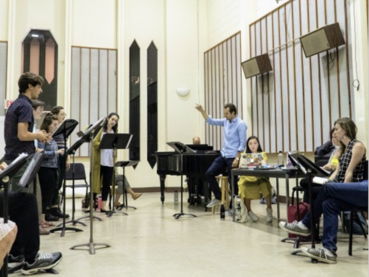 singers rehearse music together