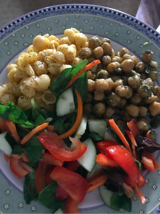 plate of food with Mac and cheese, chickpeas, and salad