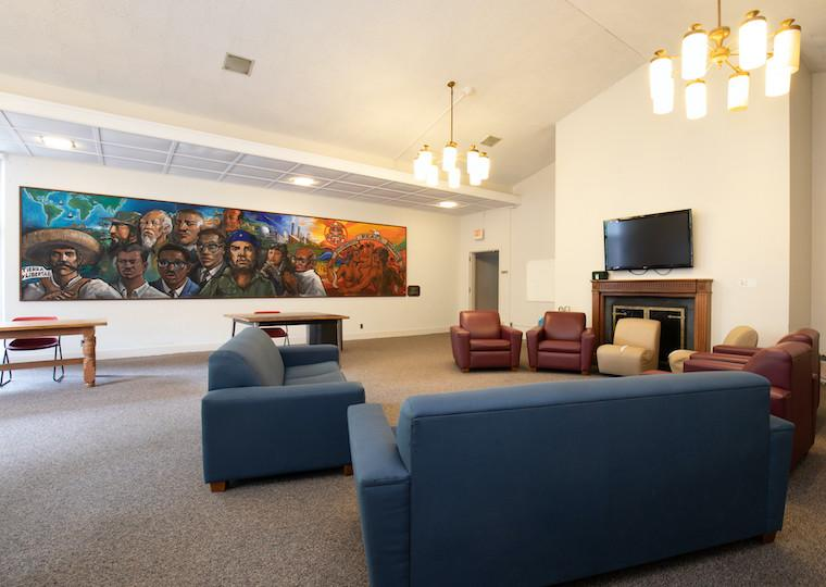 A large lounge with a mural on the back wall.