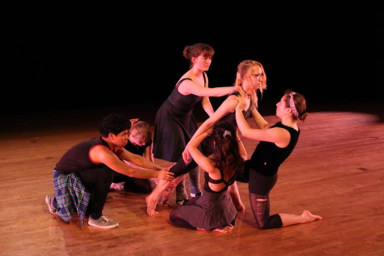 Six people perform a dance routine