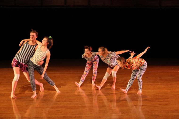 Five dancers perform a dance routine