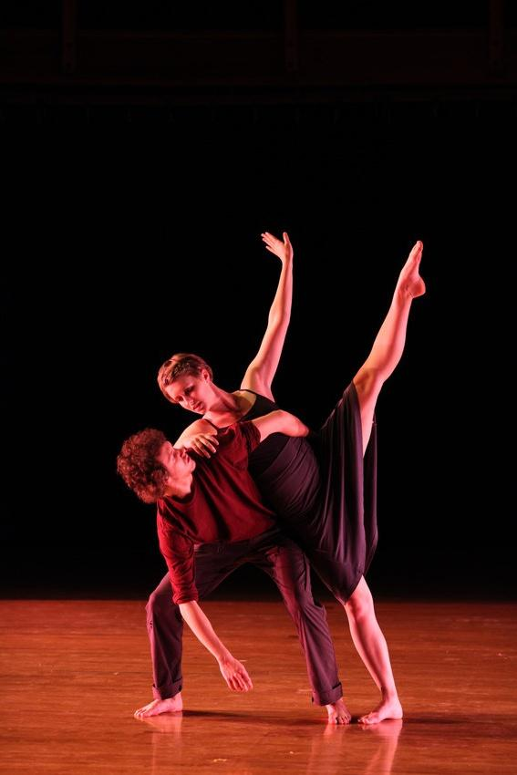 Two people perform a dance routine